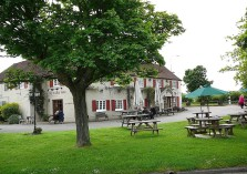 The spring inn photo with benches outside