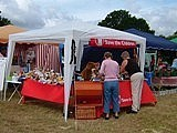 Image of a fair stall with people in the foreground